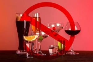 Alcoholism Warning Signs On Top Of Glasses Of Alcohol